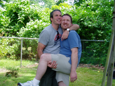 Man carrying laughing man.