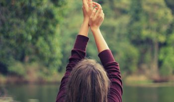 woman reaching to sky