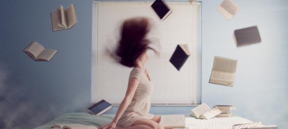 Woman with books around her head