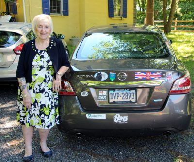 Yvonne with her car.