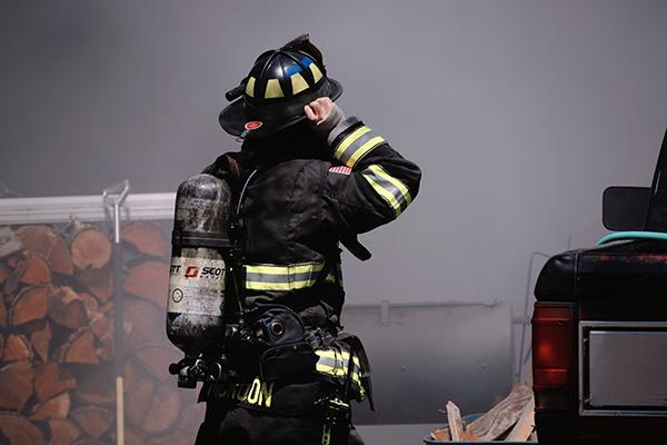 Fireman taking a break from fighting a fire.